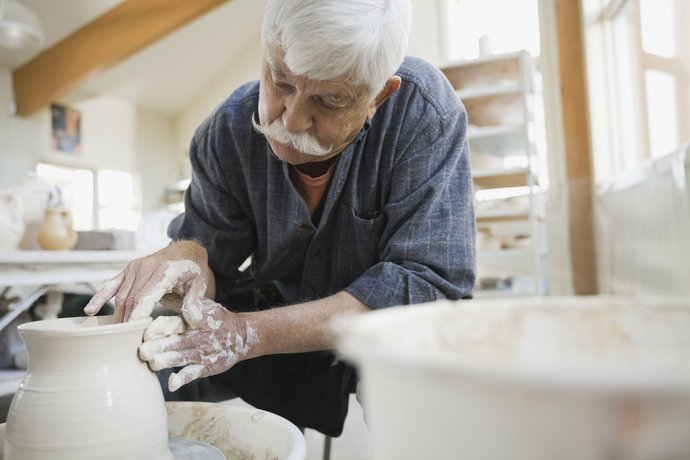 Older man creating ceramic art