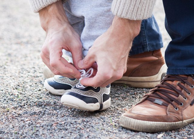 Parent tying shoelaces